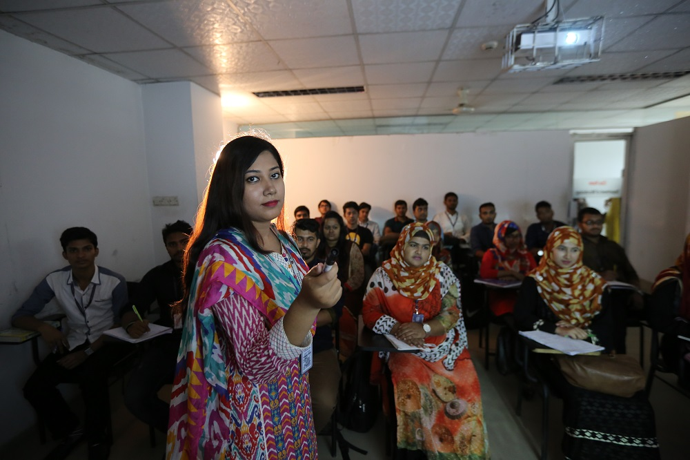 Teacher giving lecture with multimedia projector.JPG